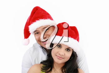 Young couple at Christmas with Santa Claus hats