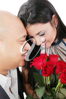 Close up of couple holding a bouquet of red roses