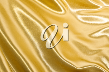 Royalty Free Photo of Golden Satin or Silk Background with Waves