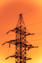 Image of power transmission tower with cables in bright tones