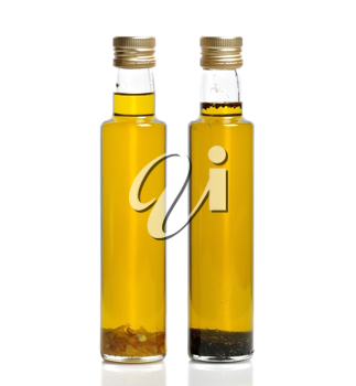 Royalty Free Photo of Bottles Of Garlic And Basil Olive Oil