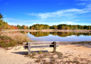 Royalty Free Photo of a Bench by a Lake