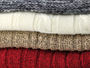 Stack of sweaters, close up
