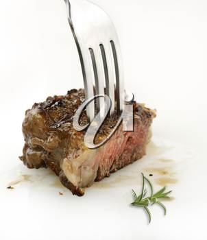 Piece Of Red  Meat Steak On A Fork,Close Up