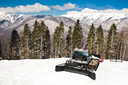 Snowplow, montains on background