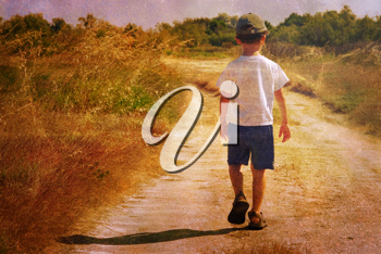 Vintage picture of a young child walking on a road