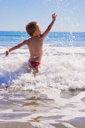 A Young child playing in the sea