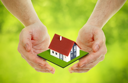 Royalty Free Photo of a Person Holding a House