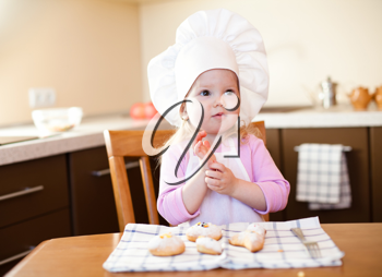 Royalty Free Photo of a Little Girl With Cookies