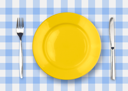 Royalty Free Photo of a Plate on a Tablecloth