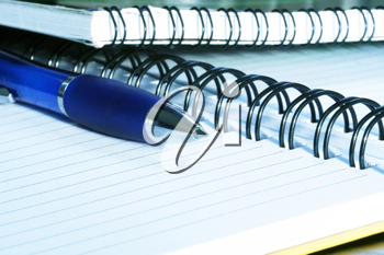 Royalty Free Photo of a Spiral Notebook and Pen