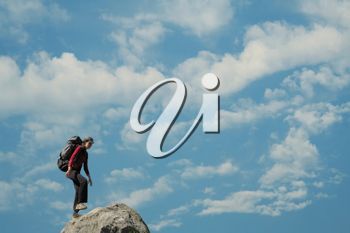 Royalty Free Photo of a Woman on a Rock Summit