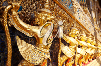 Royalty Free Photo of Golden Goruga Statues