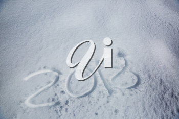 new years date 2018 written in snow background