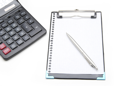Royalty Free Photo of a Calculator Beside a Clipboard