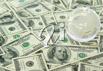 globe isolated on a dollars background