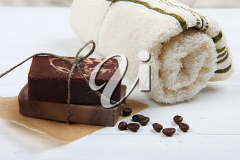 Aromatherapy spa set with natural soap on wooden background