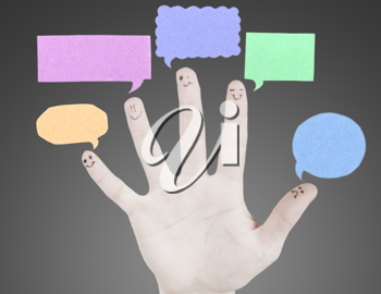 Happy group of finger smileys with social chat sign and speech thought. Fingers representing a social network.
