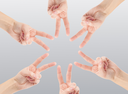 Hands of teamwork , forming the star shape