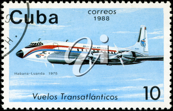 CUBA - CIRCA 1988: A Stamp printed in CUBA shows image of the airplane in transatlantic flight, Habana - Luanda in 1975, circa 1988