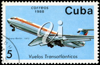 CUBA - CIRCA 1988: A Stamp printed in CUBA shows image of the airplane in transatlantic flight, Habana - Berlin in 1972, circa 1988