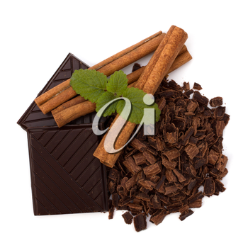 Chocolate bars and cinnamon sticks isolated on white background