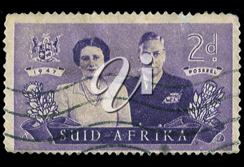 Royalty Free Photo of a South African Stamp of King George VI and Wife