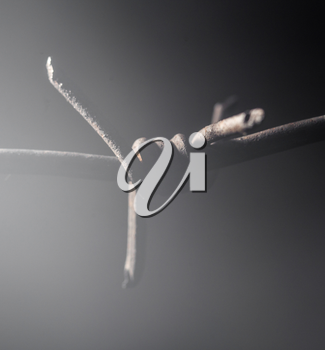 barbed wire on black background