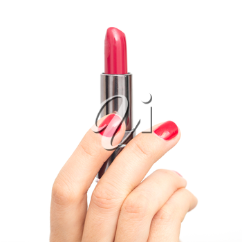 red lipstick in hand with red nail polish on a white background