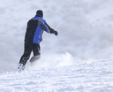 man snowboarding in the winter