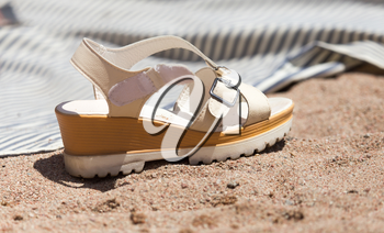 white shoes on the sand
