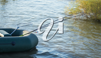 Fishing rods for fishing in a boat on the lake .