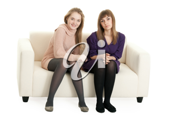 Royalty Free Photo of Two Girls Sitting on a Couch