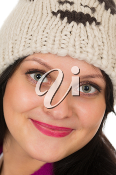 Portrait of a beautiful brunette in a warm hat,  close-up