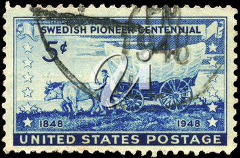 Royalty Free Photo of 1948 US Stamp Shows a Pioneer With Covered Wagon Moving Westward, Swedish Pioneer Issue