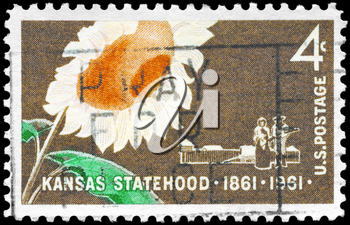 Royalty Free Photo of 1961 US Stamp Shows the Sunflower, Pioneer Couple and Stockade, Kansas Statehood Centenary