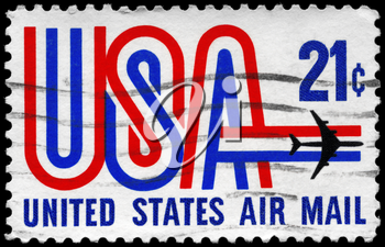Royalty Free Photo of 1968 US Stamp Shows the USA inscription and Jet