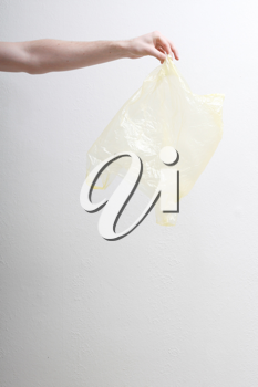 Royalty Free Photo of a Person Holding a Plastic Bag