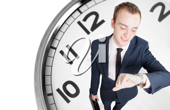 Royalty Free Photo of a Businessman by a Clock
