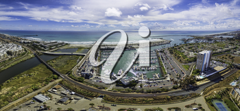 Royalty Free Photo of an Aerial Panoramic of the Oceanside Harbor in Oceanside, California, USA.