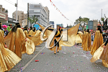 Royalty Free Photo of People Wearing Costumes Dancing in a Parade