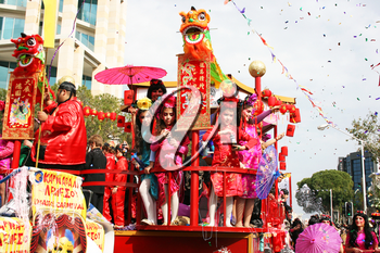 Royalty Free Photo of People on a Float in a Parade