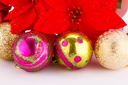 Christmas colorful balls with holly berry flowers closeup image.