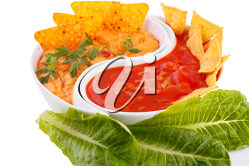 Nachos,  cheese and red sauce, vegetables isolated on white background.