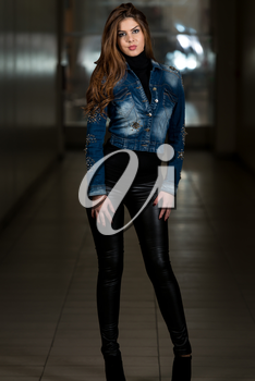 Young Woman Showing Off Blue Jacket