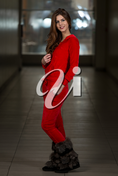 Beautiful Woman Wearing Fashion Track Suit In Red