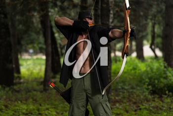 Beard Man With A Bow And Arrows In The Woods