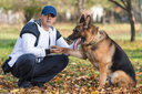 Man Holding Dog German Shepherd