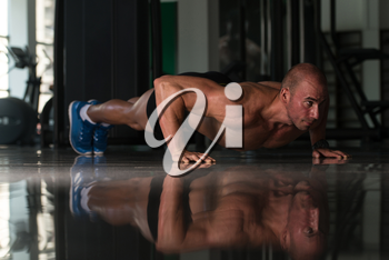Healthy Athlete Doing Push Ups As Part Of Bodybuilding Training
