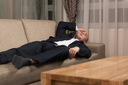 Handsome Young Man in Suit and Tie Sleeping or Resting in Sofa